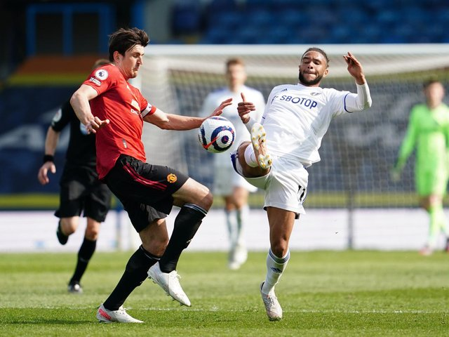 BOOKING: For Manchester United captain Harry Maguire, left, after catching Leeds United forward Tyler Roberts, right. Photo by Jon Super - Pool/Getty Images.