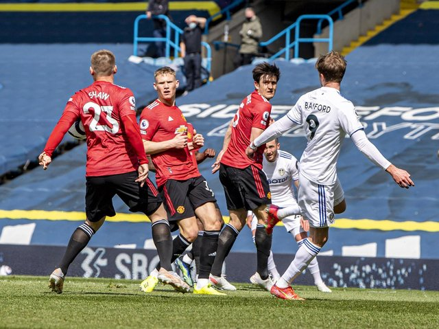 CONTENTIOUS: Manchester United survive Leeds United's claims for a penalty despite a cross from Jack Harrison, far side, being cut out by Luke Shaw's arm, left. Photo by Tony Johnson.