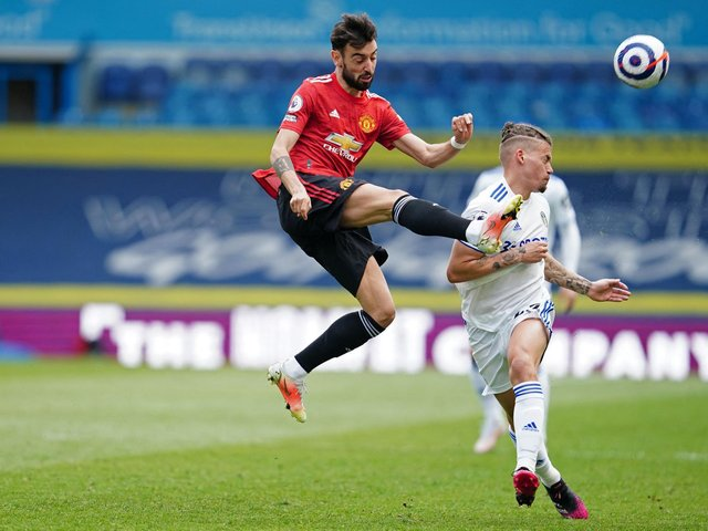 ON THE SCENE: Leeds United's England international midfielder Kalvin Phillips, right, challenges Manchester United star Bruno Fernandes, left, in Sunday's goalless draw at Elland Road. Photo by JON SUPER/POOL/AFP via Getty Images.