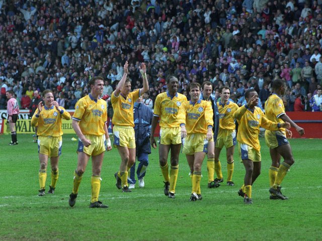 Leeds United's players celebrate at full-time with supporters at Bramall Lane. Pic: Yorkshire Evening Post