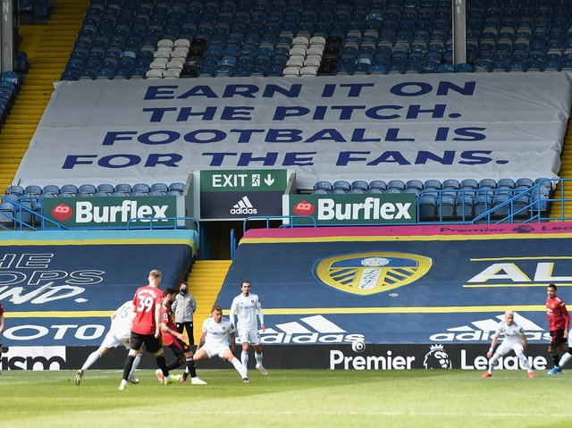 Leeds United's 'earn it' banner at Elland Road. Pic: Getty