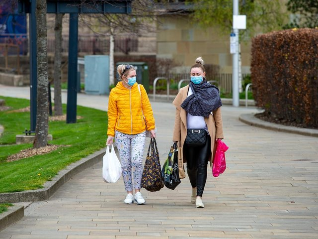 Women in masks pictured in Bradford as report outlines widening gender gap in the North of England as a result of the Covid-19 pandemic