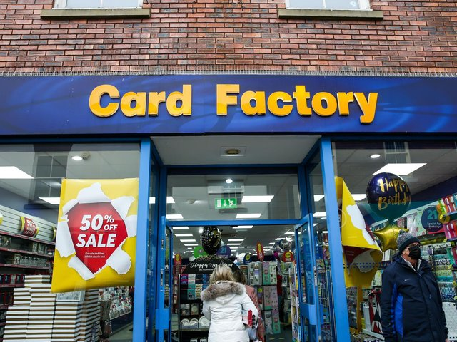 File photo of shoppers entering the Card Factory in Newcastle-under-Lyme, Staffordshire.