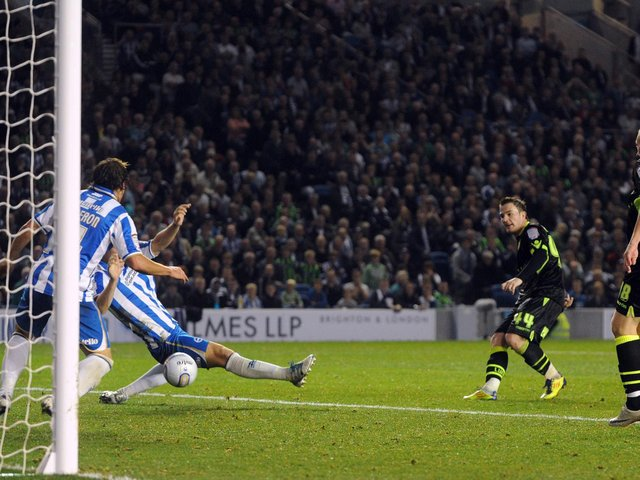 LATE TWIST: Ross McCormack nets in second half stoppage time to salvage Leeds United a 3-3 draw at Brighton in a game in which Simon Grayson's Whites led 2-0 only to trail 3-2. Picture by Steve Riding.