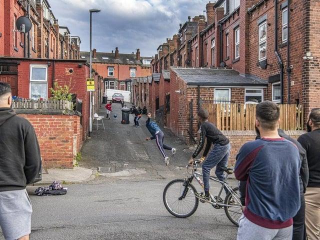 YEP photographer Tony Johnson's shot captures a street cricket match in Harehills in full swing
