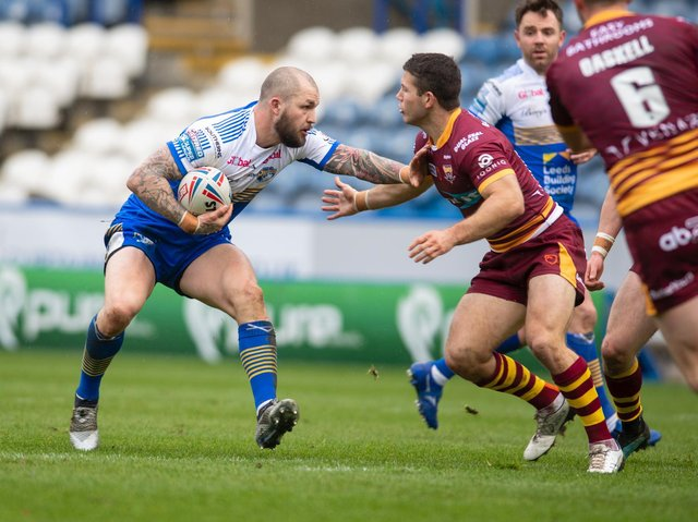 Luke Briscoe in action during Rhinos' pre-season defeat at Huddersfield. Picture by Tony Johnson.