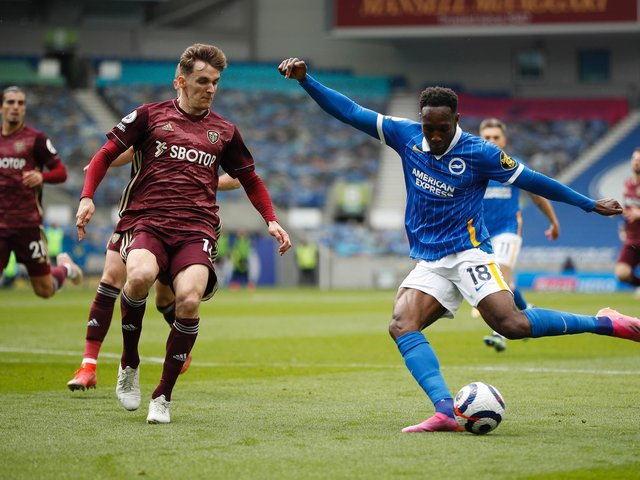 MENACE: Brighton forward Danny Welbeck, right, pictured during Saturday's clash at the Amex as Leeds United's Diego Llorente, left, looks to close in. Photo by John Sibley - Pool/Getty Images.