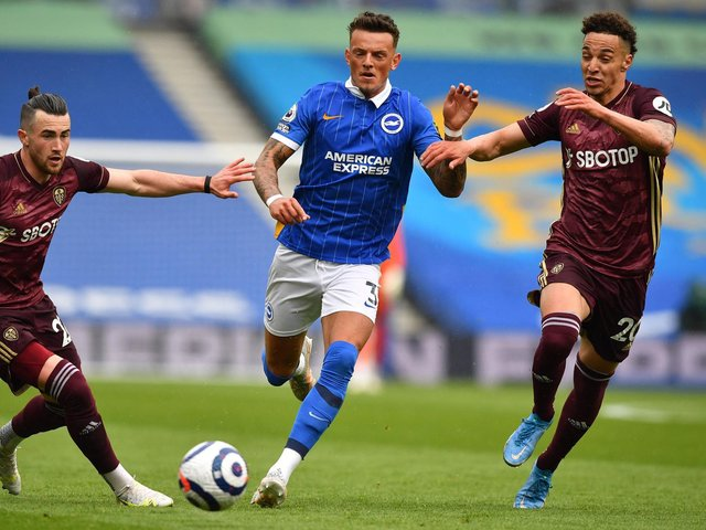 FAMILIAR FACE: Brighton's former Whites loanee Ben White, centre, strides on as Leeds United duo Jack Harrison, left, and Rodrigo, right, look to challenge. Photo by BEN STANSALL/POOL/AFP via Getty Images.