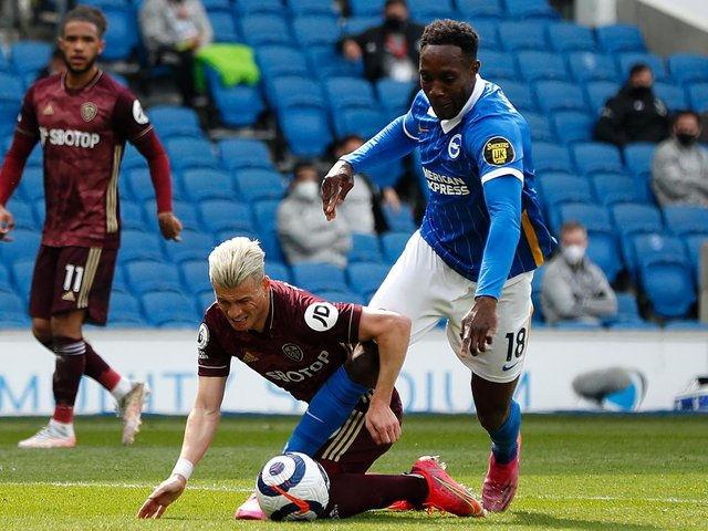 TURNING POINT - Gjanni Alioski's foul on Danny Welbeck gifted Brighton a chance to open the scoring and grab an all-important first goal against Leeds United. Pic: Getty