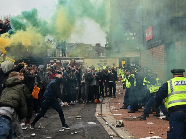 UGLY SCENES: At Old Trafford as fans protest against Manchester United's Glazer family ownership and clash with police. Photo by OLI SCARFF/AFP via Getty Images.