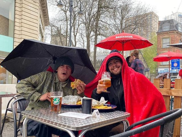Two men defying the weather and tucking into their beer and gyros at Tavassoli's Cafe + Grill. Photo credit: Tavassoli's Cafe + Grill
