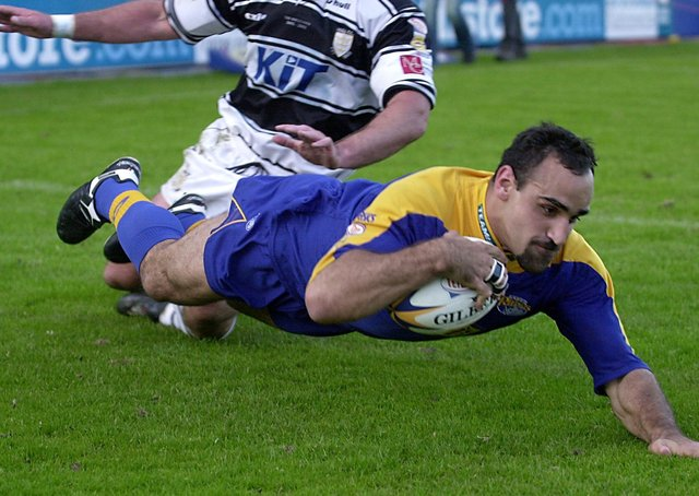 Tonie Carroll diving in for a try for Leeds against Hull in May 2002. Picture: Steve Riding.