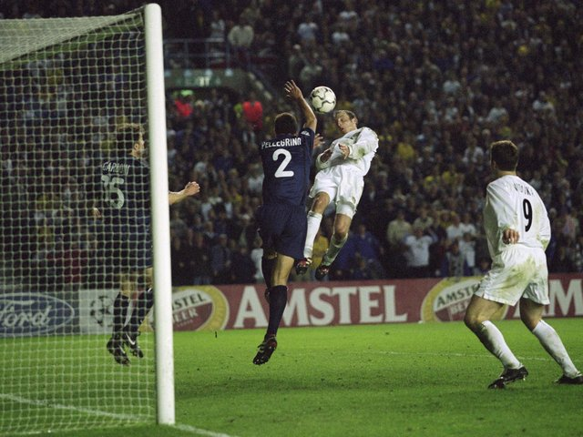 SO CLOSE: Lee Bowyer's header hits the crossbar as Leeds United and Valencia have to settle for a goalless draw in the Champions League semi-final at Elland Road of May 2, 2001. Photo by Alex Livesey/ALLSPORT via Getty Images.