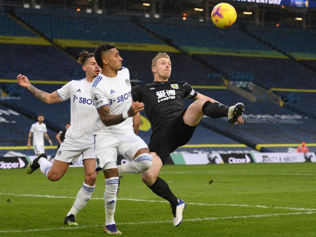 BOTH OUT: Leeds United duo Kalvin Phillips, left, and Raphinha, centre. Photo by OLI SCARFF/POOL/AFP via Getty Images.