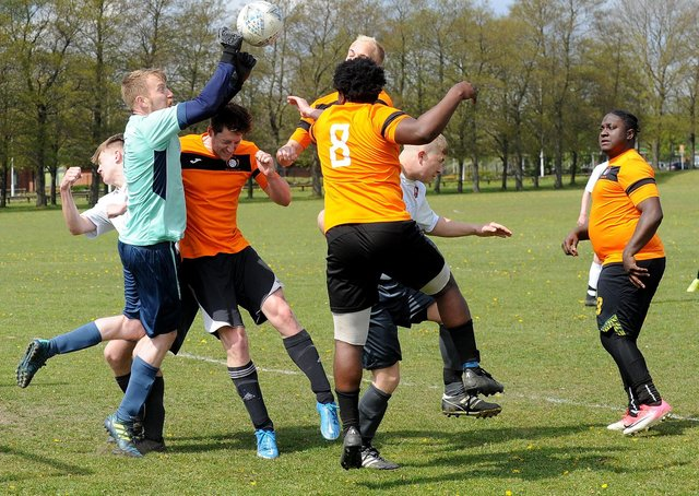 FC  Scholes goalkeeper Paul Rennison punches bravely against Beck & Call FC striker Jamie Halshaw during Sunday's Leeds Combination Division 2 encounter. Picture: Steve Riding.