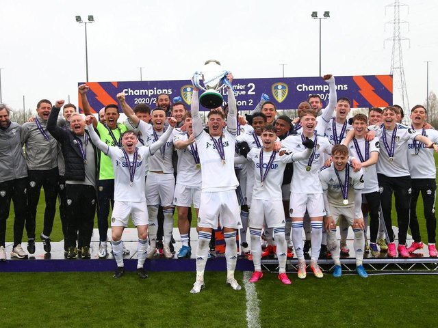 CHAMPIONS! Leeds United's under-23s captain Charlie Cresswell lifts the Premier League Two Division Two trophy at Thorp Arch. Picture by LUFC.