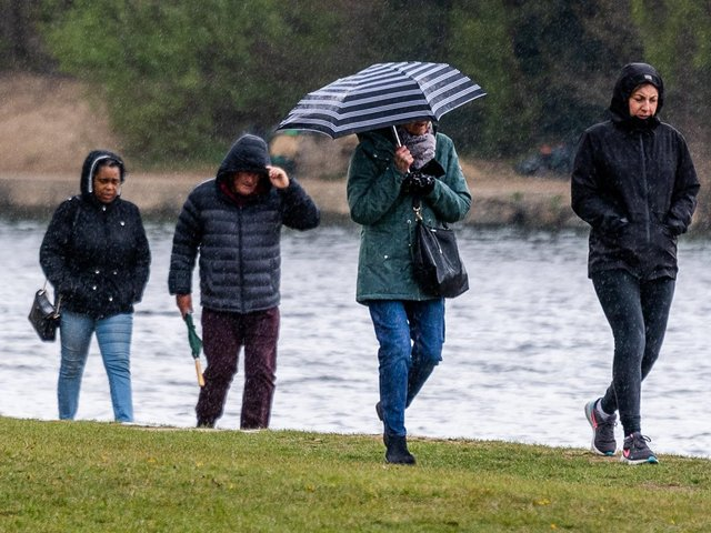 People out for a rainy walk in Roundhay Park on Bank Holiday Monday.