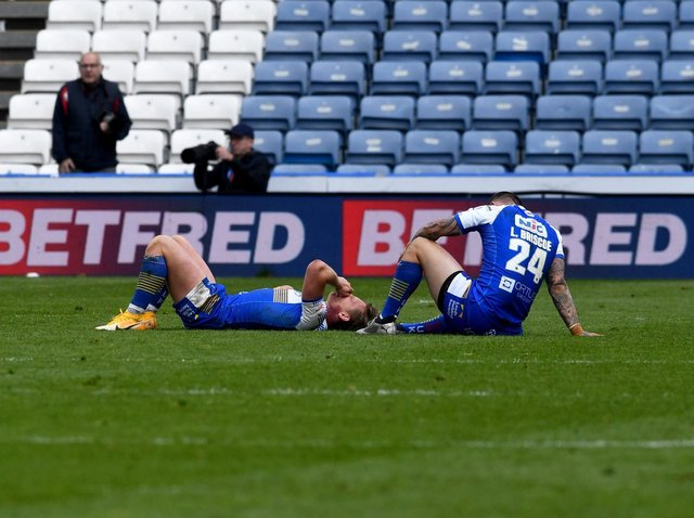 Rhinos' Brad Dwyer and Luke Briscoe were floored by the last-gasp loss at Huddersfield. Picture by Simon Hulme.