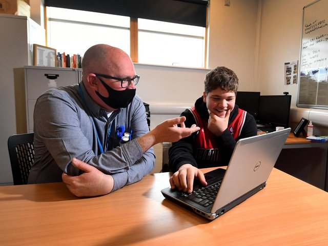 English Teacher Ben Powell pictured with student Lewis Harrison at Southway School Hub in Leeds. Picture by Simon Hulme.