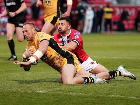 Liam Watts scores for Tigers in last week's Super League win over Salford. Picture by Paul Currie/SWpix.com.