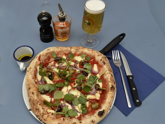 Rosa pizza, a tomato based pizza with mozarella, Piquillo pepper, olives, rocket, red onion at Grumpy's in Farsley.