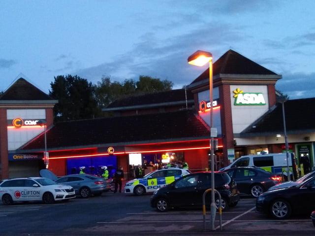 Police at the scene outside Kirkstall Road Asda.