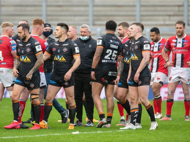 Coach Daryl Powell, centre, with his Tigers players after the dramatic win over Salford. Picture by Tony Johnson.