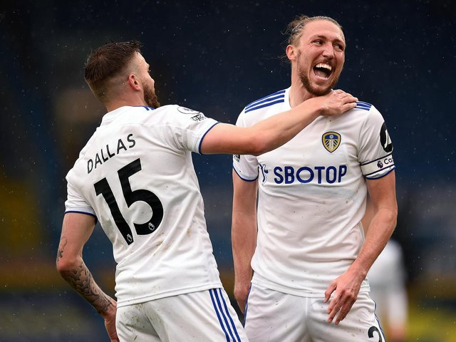 EYEING THE FANS: Leeds United's stand in skipper Luke Ayling, right, celebrating with goalscorer Stuart Dallas, left, after the Whites opener in Saturday's 3-1 victory against Tottenham Hotspur at Elland Road. Photo by Oli Scarff - Pool/Getty Images.