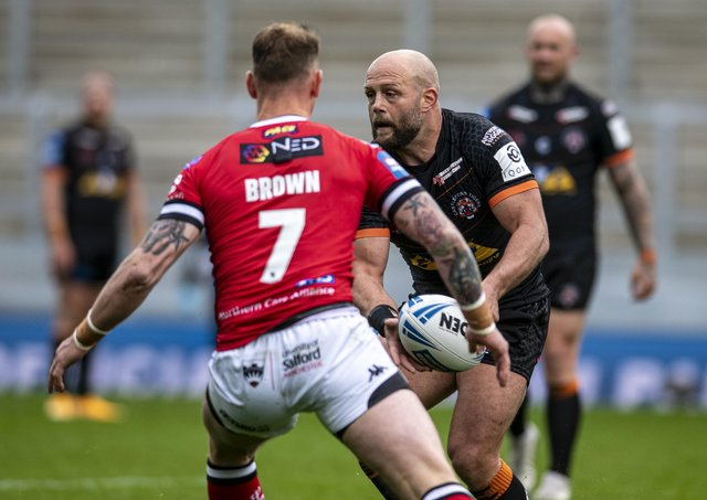 KEY MAN: Castleford Tigers' Paul McShane on the attack against Salford Red Devils. Picture: Tony Johnson.