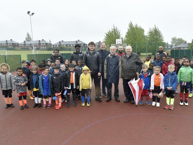 Pictured: Jake Boyd, centre left, football coach, with Freemasons Phil Fraser, Michael Rose, Alex Ullmann, Raymond Diamond from The Lodge of Dawn, Headingley, and kids from the centre. Picture: Steve Riding