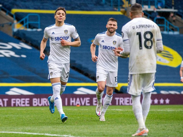 SEALED THE DEAL: Leeds United's record signing Rodrigo, left, heads to celebrate with Raphinha, right, after putting the Whites 3-1 up from his assist against Tottenham at Elland Road. Picture by Bruce Rollinson.