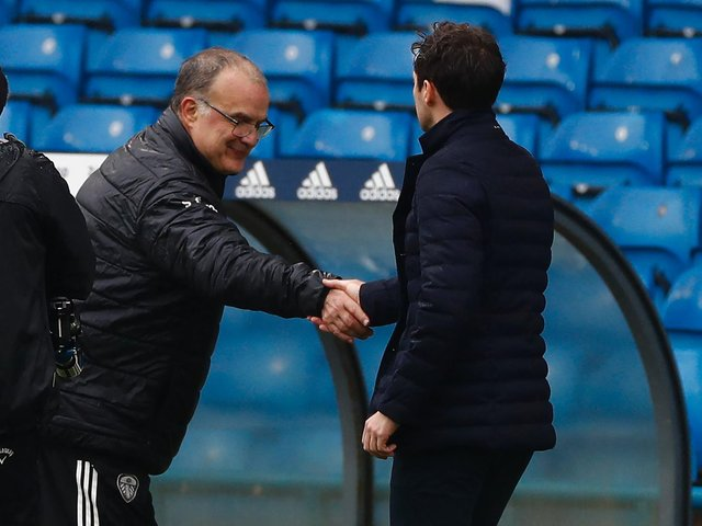 HAILING DISTANCE: Leeds United head coach Marcelo Bielsa greets Tottenham boss Ryan Mason before Saturday's clash at Elland Road which left the Whites six points behind Spurs. Photo by JASON CAIRNDUFF/POOL/AFP via Getty Images.