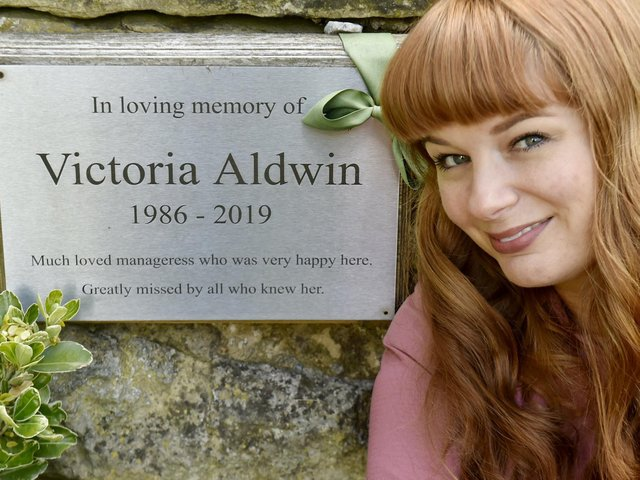 Katy Winship pictured next to a  memorial plaque to her best friend Vicki Aldwin outside Chapel Allerton pub The Mustard Pot.  Photo: Steve Riding