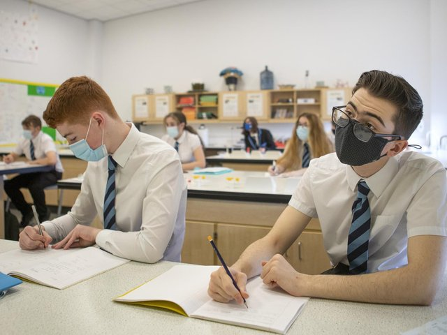 Pupils wearing masks in the classroom (photo: PA).