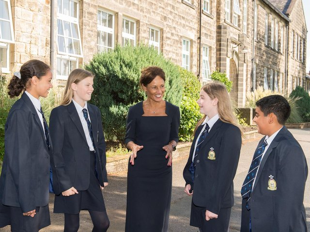 Janet Sheriff, headteacher at Prince Henry's with some pupils.