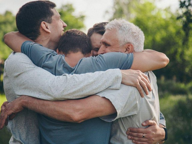 Hugging loved ones from different households is to be allowed again from next week in England, when people will be given the choice on whether to socially distance from close friends and family. cc Shutterstock