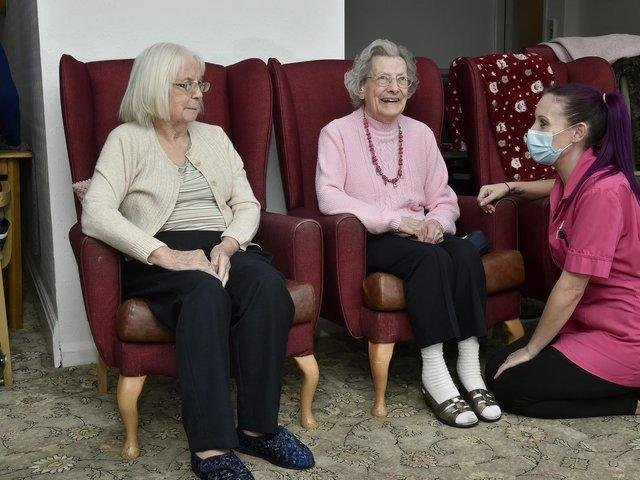 Alexandra Court care home care assistant Sam Maybury chats to residents Audrey Sykes, 86, and Vivienne Aitkin, 91, before their first Covid-19 vaccinations. Photo; Steve Riding