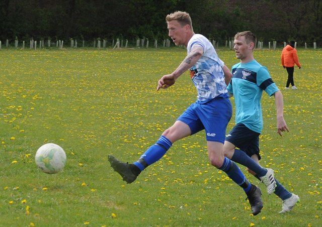 James Davies tucks away one of seven goals in Old Crooked Clock's 19-1 Leeds Combination League Division 3 win over visitors Swarcliffe FC First. Picture: Steve Riding.