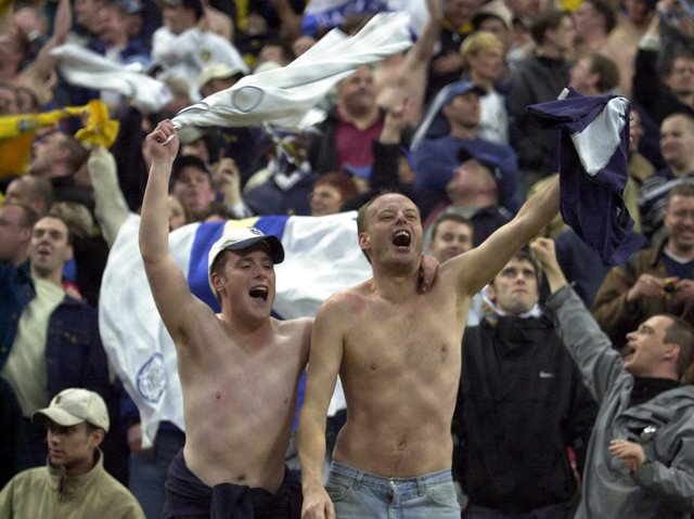 HAPPY DAYS - Leeds United fans celebrating after Dominic Matteo's goal against AC Milan at the San Siro in 2000. Whites supporters have played a huge part in his life and recovery from brain surgery. Pic: Getty