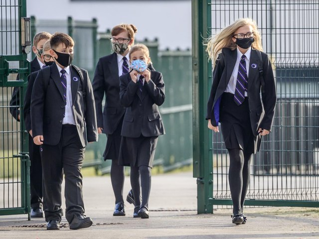 Students wearing face coverings at school.