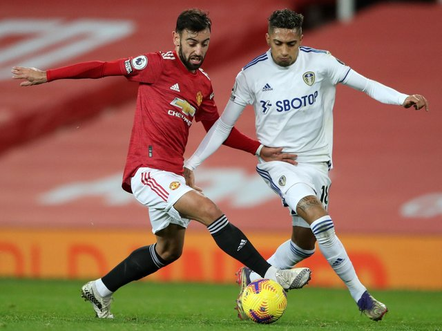 Manchester United's Bruno Fernandes battles with Leeds United's Raphinha. Pic: Getty
