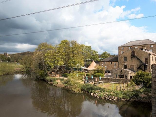 Kikrstall Bridge Inn looks over the River Aire