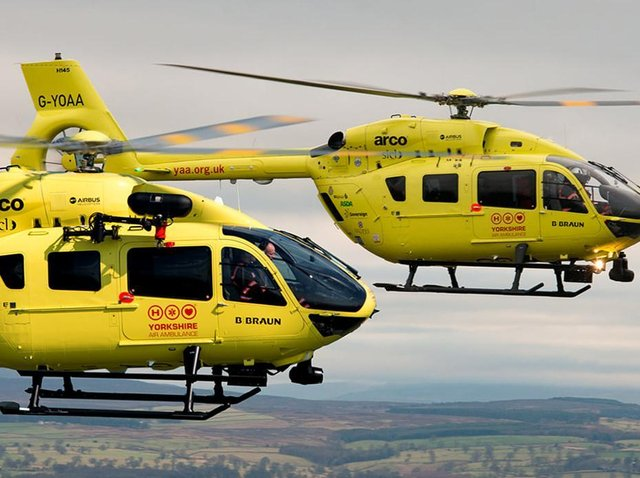 The two current helicopters in flight
