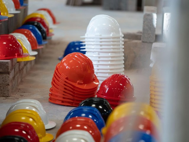 Hundreds of hard hats were laid out at Leeds College of Building to represent the tradespeople who have died by suicide.