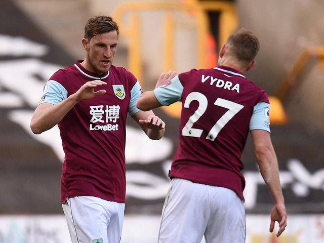 FRONT TWO: Burnley strike force duo Chris Wood, left, and Matej Vydra, right. Photo by OLI SCARFF/POOL/AFP via Getty Images.