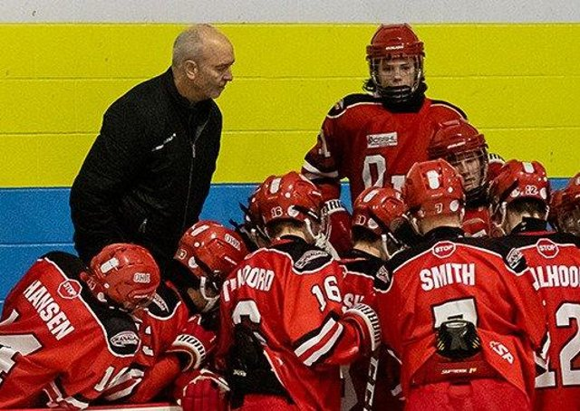 LEADING ROLE: Dave Whistle, pictured with youngsters at the Okanagan Hockley Academy in Penticton, British Columbia, is determined to grow the Leeds ice hockey franchise. Picture courtesy of OHA.