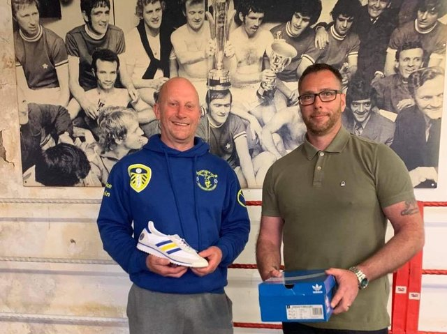 Craig Chapman of The Pool the Presenting Mike Tobin with the custom made trainers