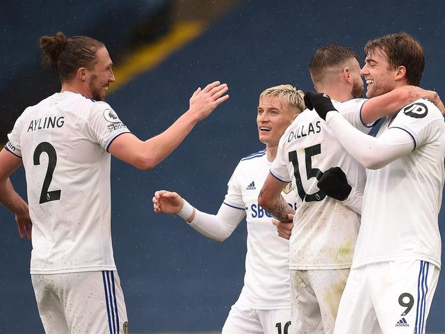 ALL SMILES: Leeds United striker Patrick Bamford, right, celebrates with his team mates after netting his side's second goal in last weekend's impressive 3-1 victory against Tottenham at Elland Road. Photo by Oli Scarff - Pool/Getty Images.