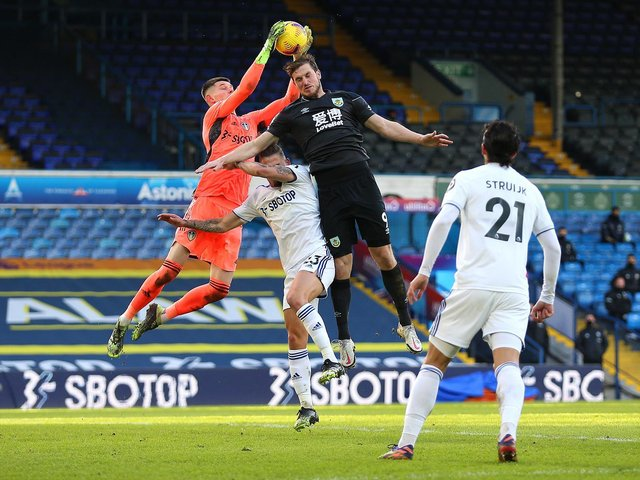 CHIEF THREAT: Burnley striker Chris Wood, centre, pictured challenging Leeds United 'keeper Illan Meslier and defender Luke Ayling in December's clash at Elland Road. Photo by Nigel French - Pool/Getty Images.