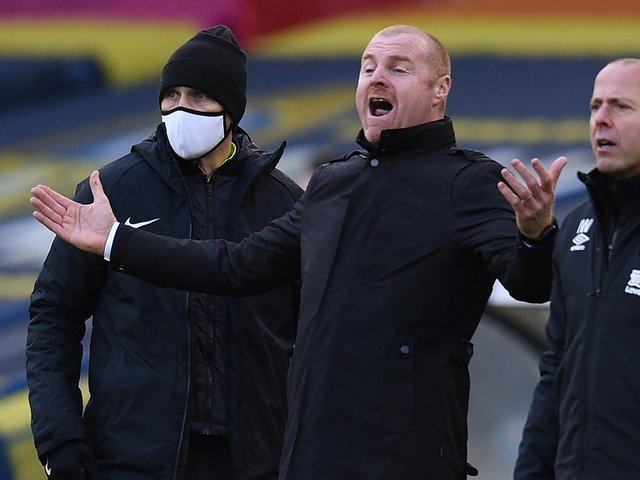 IT WASN'T ME: Says Burnley boss Sean Dyche, centre, who says he has been massively misquoted about Leeds United's transfer spend. Photo by OLI SCARFF/POOL/AFP via Getty Images.